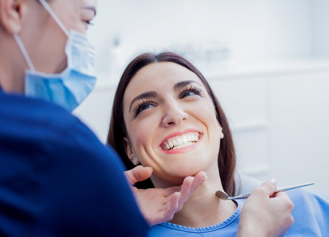 Woman at dentist photo